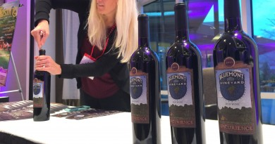 Visit Loudoun's Vice President of Marketing Jackie Saunders prepares to pour a bottle of Bluemont Vineyard's Epicurience, a collaboration blend from four local vineyards that was the signature wine at this year's Epicurience Virginia food and wine festival. (Therese Howe)