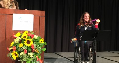 Tina Johnson of JP Events & Consulting introduces Tatyana McFadden, a Russian born marathoner who has taken home medals in wheelchair racing and skiing at multiple Paralympic games. McFadden was the 2015 Virginia Women's Business Conference on Nov. 20 at The National Conference Center (Photo by Therese Howe).
