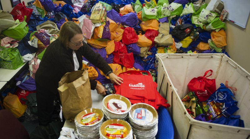 UNITED STATES - November 23, 2015: Volunteer Willa Kiser packs bags with food for the underprivileged at Interfaith Relief in time for Thanksgiving at their office in Leesburg Virginia. (Photo By Douglas Graham/Loudoun Now)