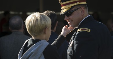 UNITED STATES - November 11, 2015 : The George C. Marshall International Center, the Town of Leesburg, and Loudoun County held a commemorate Veterans Day ceremony on the grounds of The Marshall House.  Here Army MAJ. Brett Sweeney and his son Blake age 6 have a tender moment during the ceremony on the grounds of The Marshall House. (Photo By Douglas Graham/Loudoun Now)