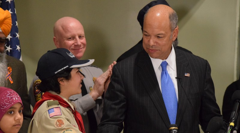 Secretary of Homeland Homeland Security Jeh Johnson shakes hands with a Muslim Boy Scout after a press conference at the All Dulles Area Muslim Society Center. Renss Greene/Loudoun Now