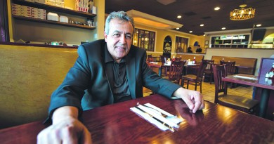 Andy Ghuzlan owner of Andy's Restaurant in Leesburg poses for some photos in his restaurant.  (Photo by Douglas Graham/Loudoun Now)