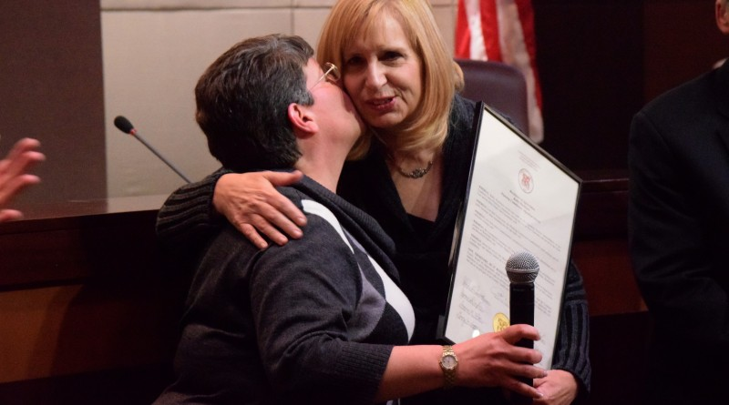 Supervisor Suzanne Volpe (R-Algonkian) plants a kiss on Commissioner Kathy Blackburn, Volpe's appointee to the planning commission. Renss Greene/Loudoun Now