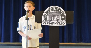 Matthew Chmielewski, a fifth-grade student at Waterford Elementary, speaks at the school's 50-year anniversary celebration Thursday, Dec. 3. (Danielle Nadler/Loudoun Now)