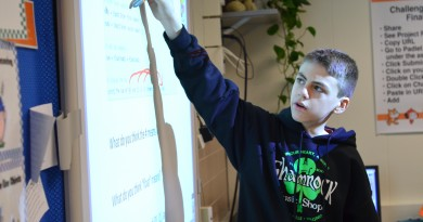 Seventh-grader Julian Frattarola translates Python computer code for his classmates in Blue Ridge Middle School's pilot coding program. [Danielle Nadler/Loudoun Now]