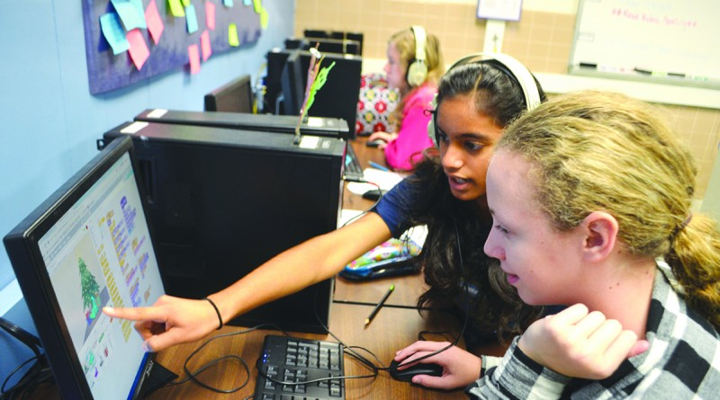 Seventh-graders Arya Tadepalli, top, and Katrina Obedin create an interactive game using coding software called Script. They are in a pilot coding program at Blue Ridge Middle School. (Danielle Nadler/Loudoun Now)