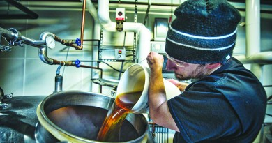 Nassim Sultan adds honey from Loudoun to a batch of root beer at Lost Rhino Brewing Company in Ashburn. (Douglas Graham/Loudoun Now)  (Photo By Douglas Graham/Loudoun Now)