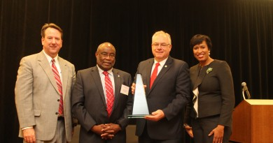 From left, Metropolitan Washington Council of Governments Executive Director Chuck Bean, Alexandria Mayor and MWCOG board Chairman William Euille, Loudoun County Chairman Scott York, and MWCOG President and DC Mayor Muriel Bowser at the ceremony recognizing York for his career accomplishments.