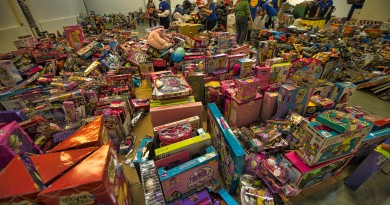 A 12,687-square-foot warehouse in Ashburn was filled to the brim this week with donated bicycles, books, games and other toys to be given to children who wouldn't otherwise have Christmas gifts to open. More than 21,000 gifts were donated to the Loudoun County Toys for Tots this year.  Douglass Graham/Loudoun Now