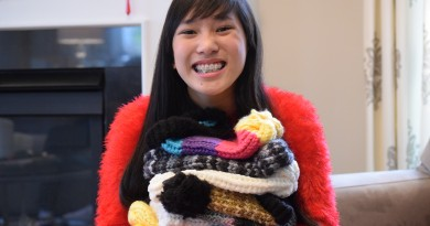 13-year-old Alexis Grandis holds a pile of warm, hand-loomed hats at her home in Leesburg. Renss Greene/Loudoun Now