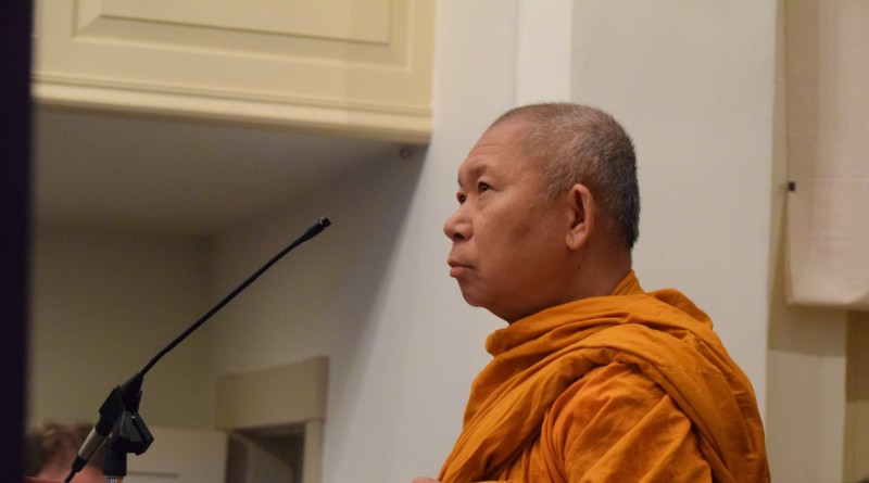 Abbot Phrakrusirithammavithes Udom Samana of Wat Yarnna Rangsee Buddhist Monastery in Sterling offers a brief prayer from the pulpit.