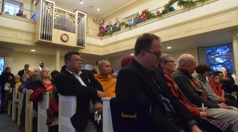 "Congregants pray in a variety of traditions, all for peace. ""I invite you to speak to God now in my words, but in the words you use to speak to God,"" said Rev. Daniel Velez Riviera of St. Gabriel's Episcopal Church in Leesburg.