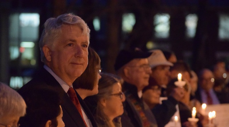 Attorney General Mark R. Herring is among those standing in silent vigil at the intersection of King and Market streets.