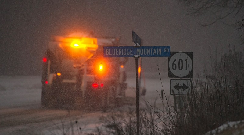 A VDOT snow plow struggles to stay ahead of the storm on top of the Blue Ridge Mountains alone route 7 and 601in Loudoun County.    [Photo by Douglas Graham/Loudoun Now]