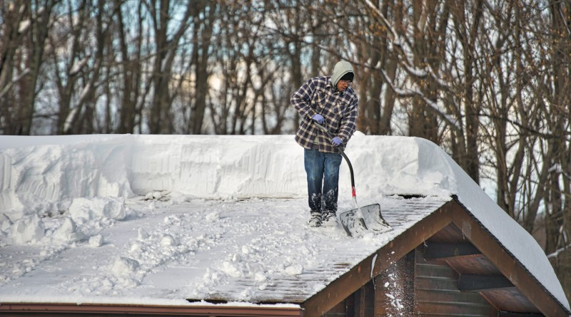 Heavy snows in the higher elevations of up to and over 3 feet had folks in Bluemont clearing their roofs as well as their drives.  (Photo by Douglas Graham/Loudoun Now)