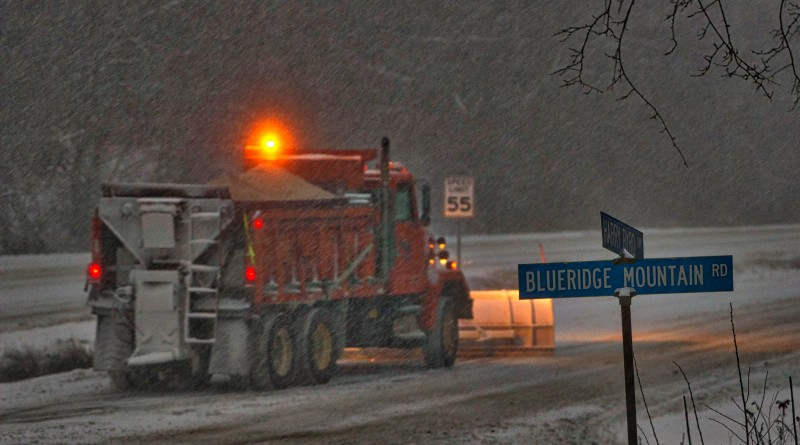 A VDOT snow plow struggles to stay ahead of the storm on top of the Blue Ridge Mountains alone route 7 and 601in Loudoun County.  (Photo by Douglas Graham/Loudoun Now)