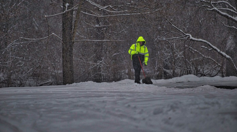 A Postal worker keeps  the sidewalks clear in the village of Bluemont.   [Photo by Douglas Graham/Loudoun Now]