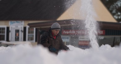 Workers clear sidewalks and parking lots in Purcellville Virginia after a two-day blizzard hit the Mid Atlantic with Loudoun County right in the bullseye of the worst part of the storm. Parts of Western Loudoun had up to 40 inches of snow.  (Photo by Douglas Graham/Loudoun Now)