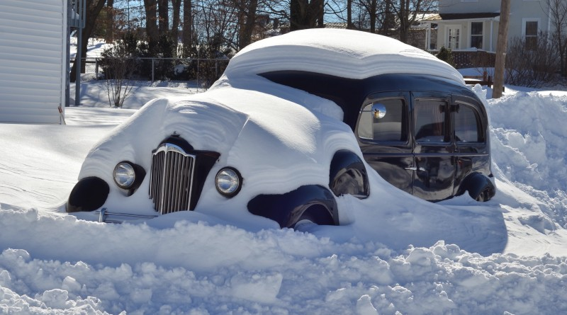 The old hearse at Colonial Funeral Home sat under 30-plus inches of snow Jan. 23, 2016. (Danielle Nadler/Loudoun Now)