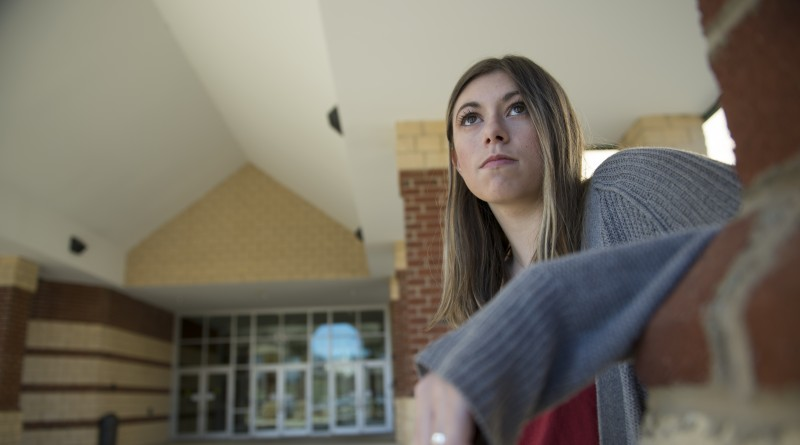 Carmine Gothard sits outside of Briar Woods High School between classes. The 17-year-old started a website and support movement for survivors of sexual violence 10 years after she was assaulted. (Photo by Douglas Graham/Loudoun Now)