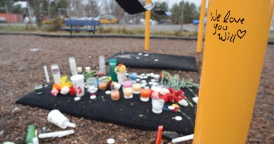 Flowers and candles left by classmates during a memorial at the site where a 17-year-old Loudoun Valley High School student committed suicide Jan. 14, 2016. (Norman K. Styer/Loudoun Now)