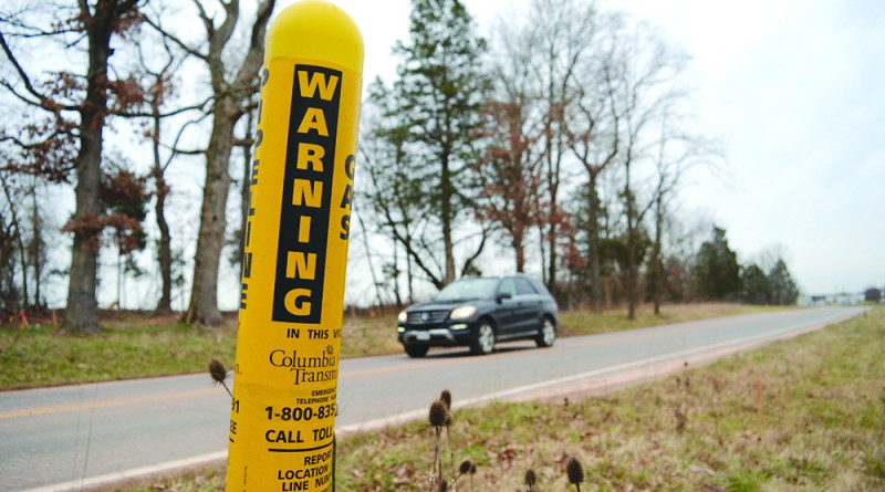 A Columbia Pipeline Group marker stands where one of two gas pipelines—which the county will pay to relocate—crosses Old Ryan Road in Ashburn.  [Renss Greene/Loudoun Now]