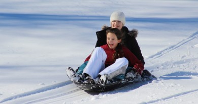 Freshmen Sarah Elhilow, of West Palm Beach, FL (front), and Kayla Lee of Austin, TX, sled down a slope at Foxcroft School's Middleburg campus.  (Courtesy of Foxcroft School)