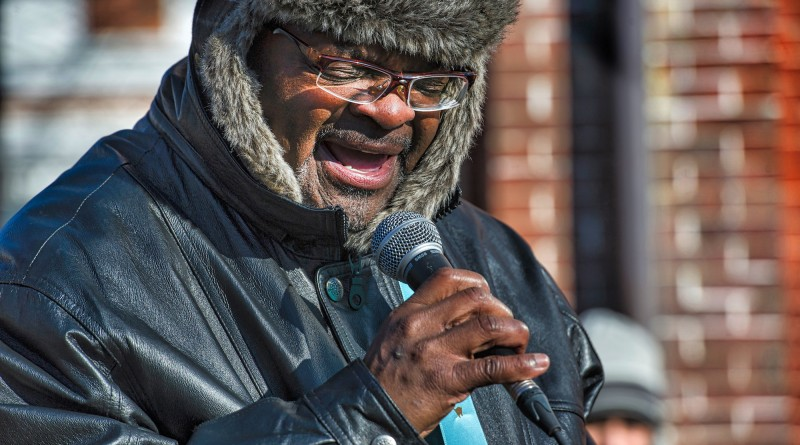 """The Rev. Jamila Gault performs the invocation at the Loudoun County Court House in downtown Leesburg before the march to Douglass Community Center for the 24th annual Martin Luther King Jr. """"I Have a Dream"""" celebration.  (Photo by Douglas Graham/Loudoun Now)"""