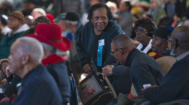 """Anne Day greets friends at Douglass Community Center after marching from Loudoun County Court House in downtown Leesburg to Douglass Community Center for the 24th annual Martin Luther King Jr. """"I Have a Dream"""" celebration.  (Photo by Douglas Graham/Loudoun Now)"""