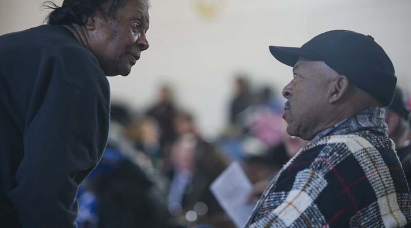 """Anne Day and Willie Washington, former basketball coach at Loudoun County High School, greet each at Douglass Community Center after marching from Loudoun County Court House in downtown Leesburg to Douglass Community Center for the 24th annual Martin Luther King Jr. """"I Have a Dream"""" celebration.  (Photo by Douglas Graham/Loudoun Now)"""