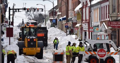 Crews on King Street in downtown Leesburg continued the massive snow removal effort three days after storm Jonas. (Norman K. Styer/Loudoun Now)