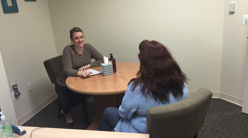 Psychiatric Rehabilitation Services case manager Kelli Robertson, left, meets with a Turning Point client. (Courtesy of Turning Point)