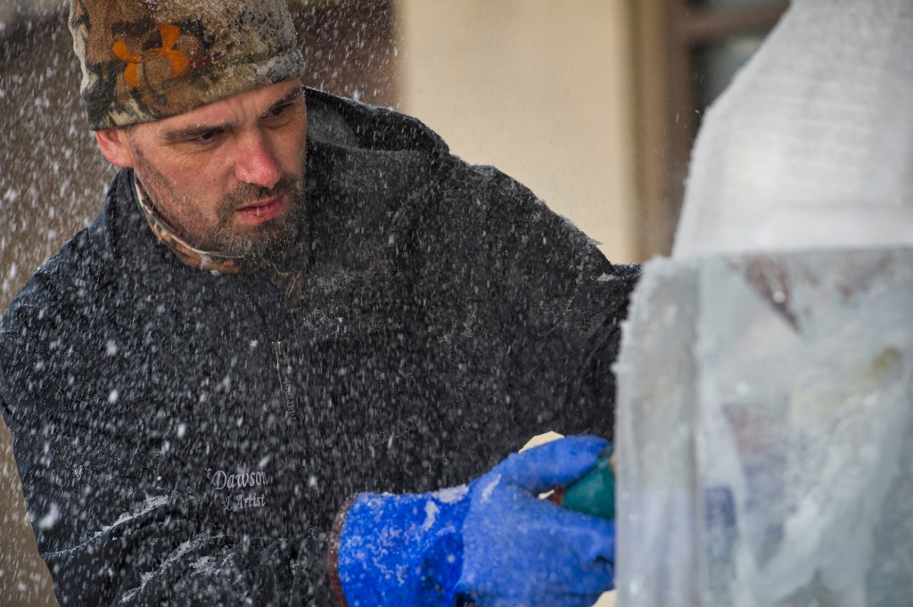 Todd Dawson works on his ice sculpture during the third Annual Winter Ice Fest and Mega Block Ice Carving Competition. Ten world-class ice carvers went head to head on January 16 at the Village at Leesburg. The competition has been sanctioned by the National Ice Carving Association. (Photo by Douglas Graham/Loudoun Now)