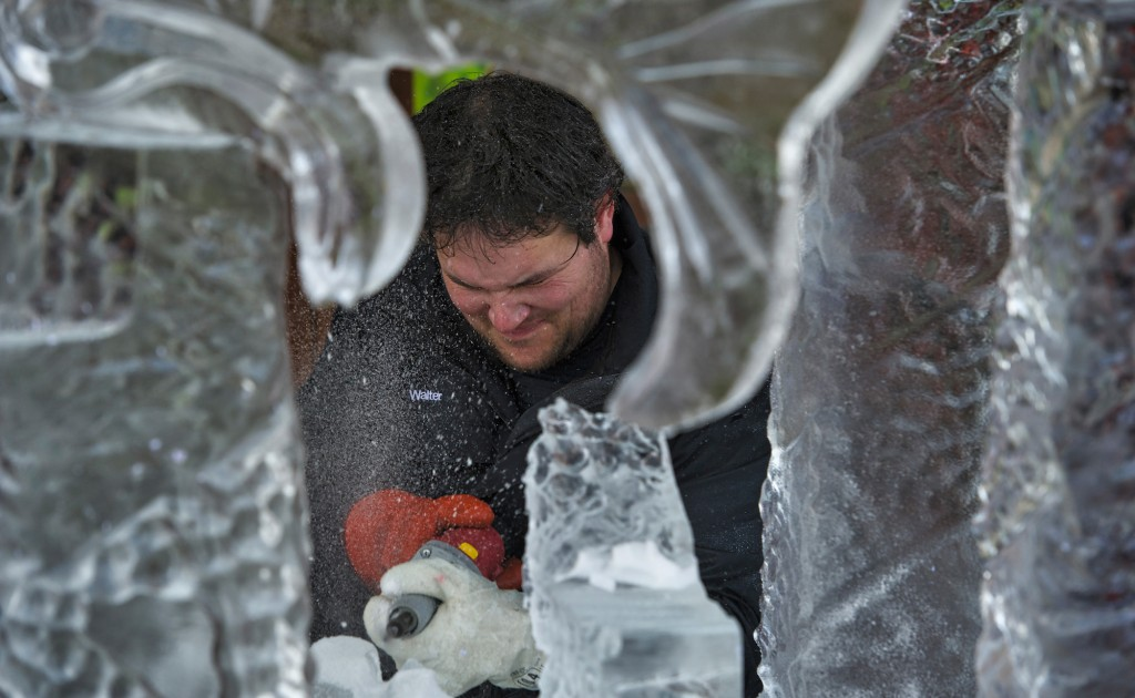 Walter Ross works on his ice sculpture during the 3rd Annual Winter Ice Fest and Mega Block Ice Carving Competition. Ten world-class ice carvers went head to head on January 16 at the Village at Leesburg. The competition has been sanctioned by the National Ice Carving Association. (Photo by Douglas Graham/Loudoun Now)