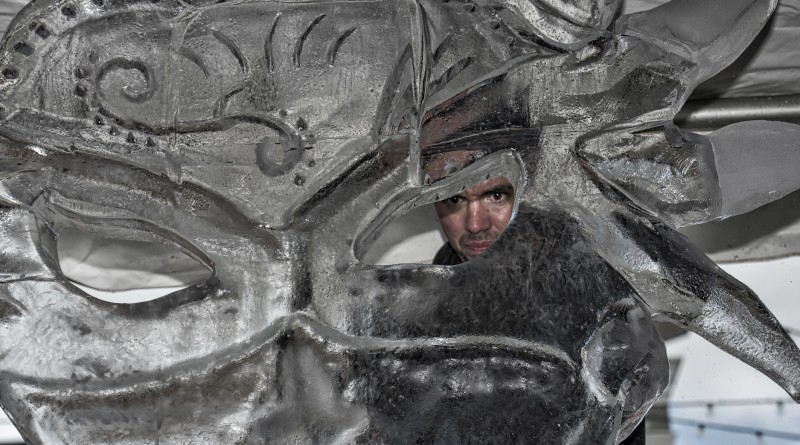 Rich Daily works on his ice sculpture during the third Annual Winter Ice Fest and Mega Block Ice Carving Competition. Ten world-class ice carvers went head to head on January 16 at the Village at Leesburg. The competition has been sanctioned by the National Ice Carving Association. (Photo by Douglas Graham/Loudoun Now)