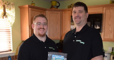 Genius Jerky founder Richard Plebuch, left, and partner Steven Brewster pose with their product packaging and various jerky spices. They spent the week promoting Genius Jerky's Kickstarter campaign, which launches next week.  [John McNeilly/Loudoun Now]