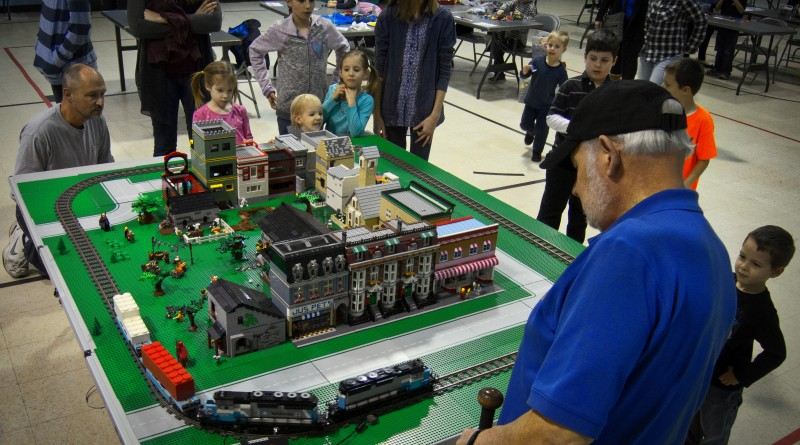 Gene Nazarowitz, age 69 from New York, works on his project during LEGO Mania at the Lovettsville Community Center. LEGO enthusiasts ages 3 and older showed up with their bricks and built projects that were judged at this annual event. (Photo by Douglas Graham/Loudoun Now)