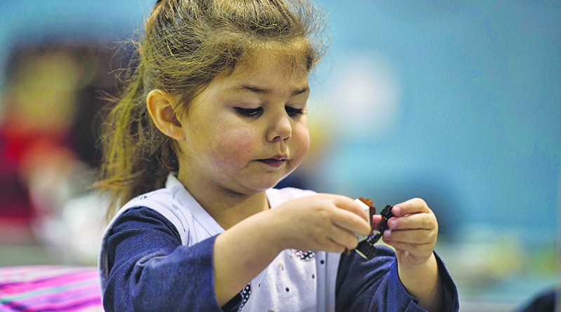 Melodie Schilling age 3 works on her project during LEGO Mania at the Lovettsville Community Center. 