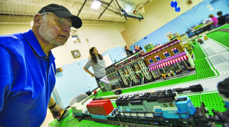 Gene Nazarowitz age 69 from New York works on his project during LEGO Mania at the Lovettsville Community Center. LEGO enthusiasts ages 3 and older showed up with their bricks and built projects that where judged at this annual event. (Photo by Douglas Graham/Loudoun Now)