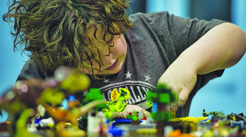 Hunter Chandler, age 11 from Lovettsville, works on his project during LEGO Mania at the Lovettsville Community Center. 
