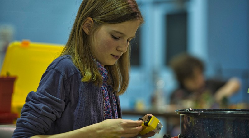 Hannah Zielke, age 12 from Purcellville, works on her project during LEGO Mania at the Lovettsville Community Center.  (Photo by Douglas Graham/Loudoun Now)