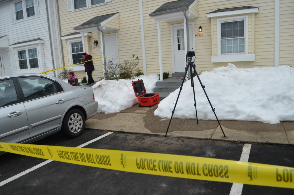 A family in the Plaza Street townhomes heads to the bus stop near the crime scene an apparent domestic-related homicide. (Danielle Nadler/Loudoun Now)