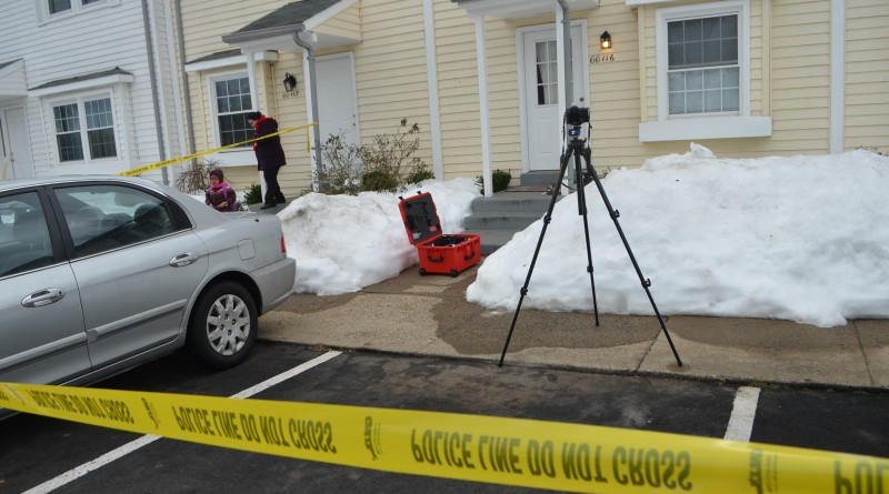 A family in the Plaza Street townhomes heads to the bus stop near the crime scene  an apparent domestic-related homicide Feb. 1, 2016. (Danielle Nadler/Loudoun Now)
