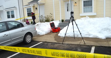 A family in the Plaza Street townhomes in Leesburg heads to the bus stop near the crime scene  of an apparent domestic-related homicide. (Danielle Nadler/Loudoun Now)