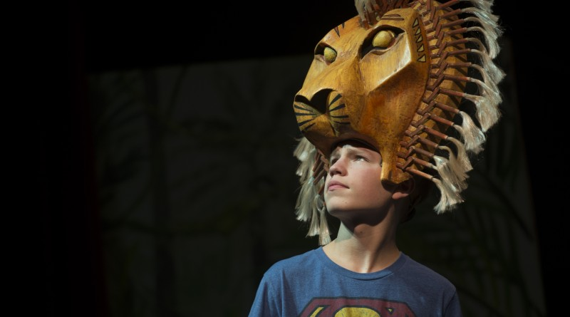 """Ian Carlson, """"Simba,"""" of Blue Ridge Middle School, performs during a dress rehearsal of the upcoming production of """"The Lion King Jr.""""(Douglas Graham/Loudoun Now)"""