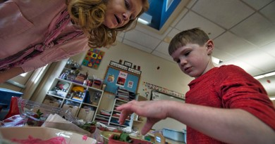 Kindergartner Andrew Roos and his teacher Julie Roberts make chocolate-covered strawberries during class at Loudoun County Day School in Leesburg. (Douglas Graham/Loudoun Now)