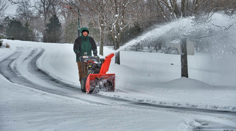 Mike Heel uses a snow blower to clear his drive after a snow storm blanketed Loudoun yet again with snow and ice.  (Photo by Douglas Graham/Loudoun Now)