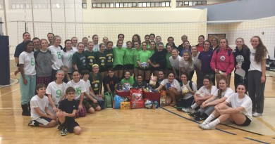 """Western Loudoun Volleyball Club players surround 200 pounds of food donated to Interfaith Relief Services and Loudoun County Animal Services Pet Pantry, which was donated at its recently held """"Certapalooza"""" intersquad scrimmage program."""