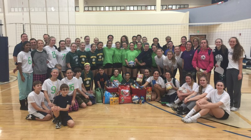 "Western Loudoun Volleyball Club players surround 200 pounds of food donated to Interfaith Relief Services and Loudoun County Animal Services Pet Pantry, which was donated at its recently held ""Certapalooza"" intersquad scrimmage program."