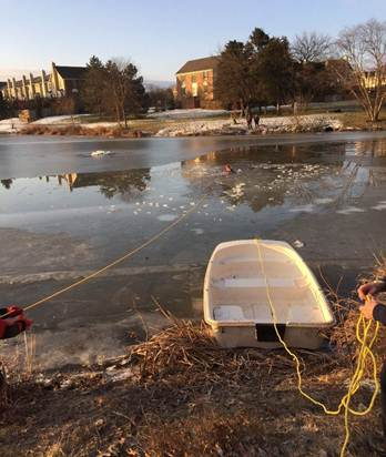 A dog was rescued from this Ashburn Farm pond after falling through the ice Wednesday morning.  [Loudoun County Fire-Resce]